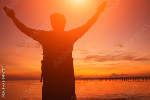 Fototapety, obrazy: Silhouette of a man  in the beautiful sunrise.