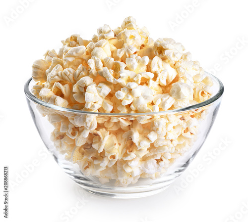 Popcorn in a glass bowl isolated on a white background.