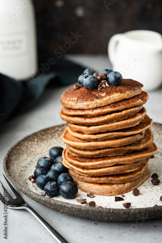 Pancakes with buckwheat and oat flour. Healthy vegan pancakes. Chocolate pancakes