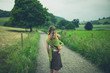 Young mother standing in country road with toddler