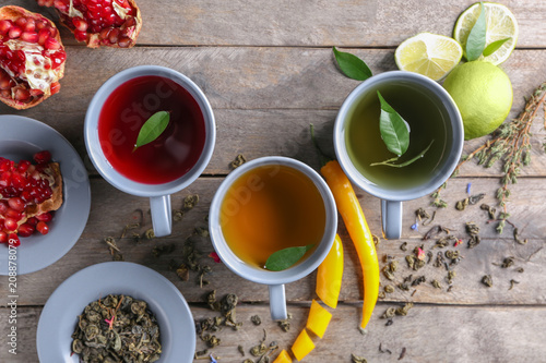 Fotobehang Thee Composition with cups of hot tea on wooden table