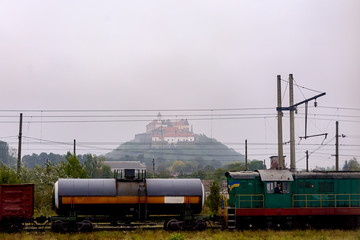 Fototapeta na wymiar Train against the background of Palanok Castle in Mukacheve