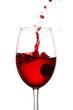 explosive splash of red wine in a glass