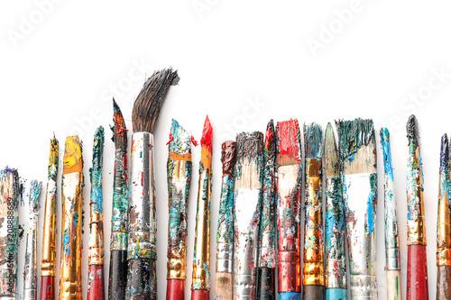Obraz na plátne Dirty paint brushes on white background