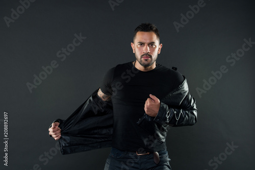 Fotografie, Obraz  Macho undress leather jacket