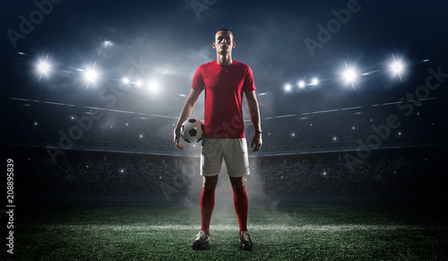 Soccer player in the stadium background. Fototapeta