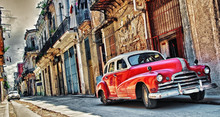 Old American Car Parked With Havana Building In Background