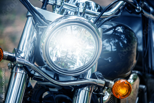 Fotobehang Fiets Motorcycle headlight close up, film blue tone style