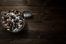 Pile Of Colorful Beans On Dark Wooden Background