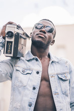 African Man With Vintage Radio...