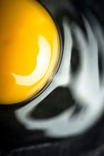 Broken Raw Egg Yolk On Dark St...