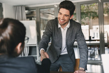 Business, Career And Placement Concept - Joyful Young Man 30s Smiling And Shaking Hands With Businesswoman, When Was Recruited During Interview In Office
