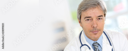 Fotobehang Sportwinkel Portrait of attractive senior doctor, template