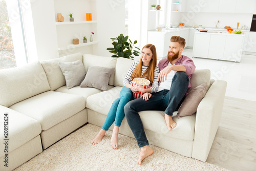 Fototapety, obrazy: Day freetime chill two partners people ginger hair vacation concept.  Cute sweet careless handsome beautiful excited cheerful lovers eating pop corn from basket watching favorite film in living room
