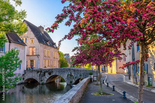 Foto op Canvas Europa Eure River embankment with old houses in a small town Chartres, France