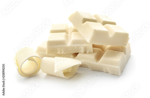 Pieces of chocolate and curls on white background