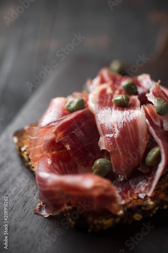 Cuadros en Lienzo Traditional Spanish Jamon Serrano ham, Prosciutto Crudo, Parma ham, Italian antipasto, served on toasted bread