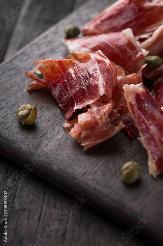 Cuadros en Lienzo Traditional Spanish Jamon Serrano ham, Prosciutto Crudo, Parma ham, Italian antipasto, served with capers