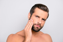 Attractive, Unhappy, Displeased, Harsh, Virile Macho Having Problem With Face, Holding Hand On Cheek, He Needs Lotion, Cream, Mask To Make Soft, Smooth, Clear, Clean Skin, Isolated On Gray Background