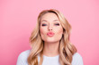 canvas print picture - Portrait of cute lovely girl in casual outfit with modern hairdo sending blowing kiss with pout lips looking at camera  isolated on pink background. Affection feelings concept