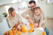Family making orange juice