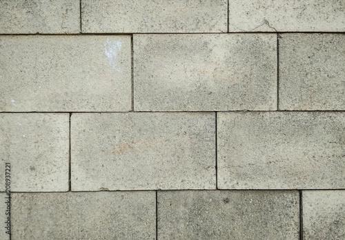 Foto op Plexiglas Wand Concrete tiles wall texture background. Vertical photo.