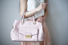 Young Woman With Light Pink Handbag, Romantic Casual Style