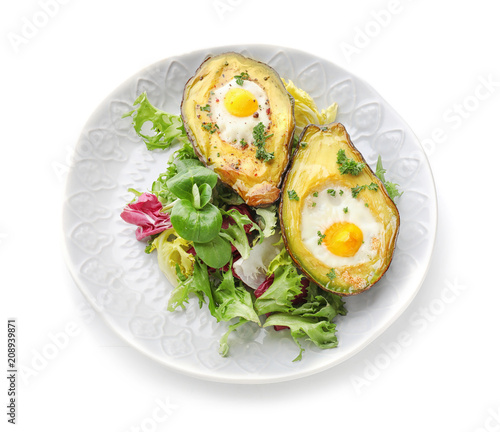 Fototapeta Baked avocado with eggs and vegetables on white background obraz
