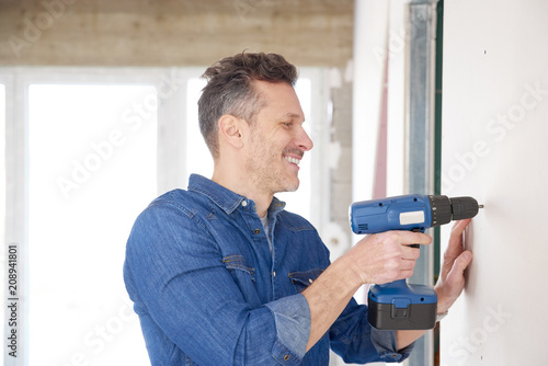 Handyman working with drill