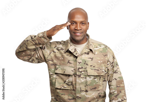 Tablou Canvas Smiling African American Soldier Renders a Salute in Uniform