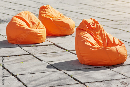 Three coloroful orange beanbags chairs for relaxing outdoor Wallpaper Mural