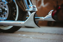 Part Of Luxury Motorcycle. Close Up Of Shiny Chromed Retro Fishtail Exhausted Pipes. Soft Lighting, Vintage Look