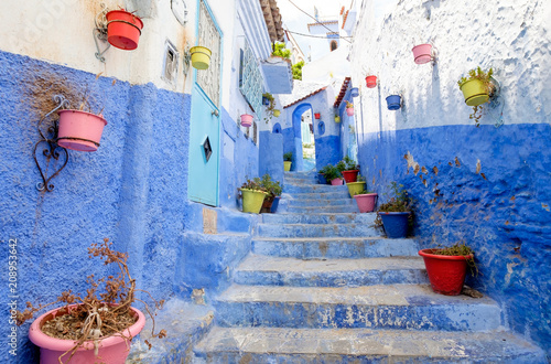 Deurstickers Street landscape of the of old historical medieval city Сhefchaouen in Morocco. Blue town village narrow streets of medina
