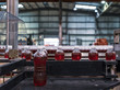 Bottles of red soda in the factory line.