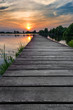 Wooden path over the lake at sunset