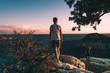 young man admires the Magnificent Grand Canyon, Arizona, USA.