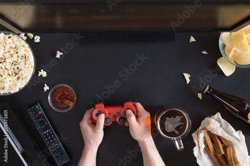 Top view of Snacks and unhealthy food with laptop on black background, gamer con Poster
