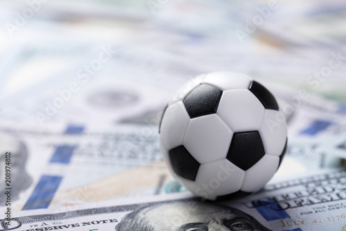 Valokuva Soccer ball on dollar banknotes
