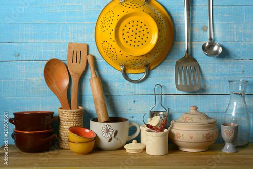 Valokuva  pile of kitchen utensils on light blue background - horizontal