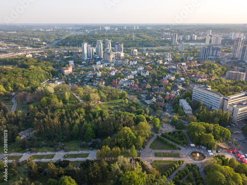 Spoed Foto op Canvas Kiev A bird's eye view, panoramic view from the drone to the view of the central alley of the Botanical Garden and the construction of the Pechersk district in the city of Kiev, Ukraine