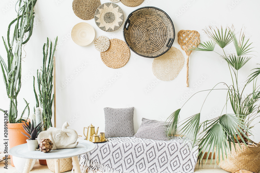 Fototapety, obrazy: Modern minimal home interior design. Pillows, golden teapot, decorative straw plates, Scandinavian blanket, tropical palm tree, succulent and decorations.