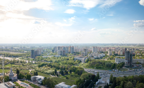 Foto op Plexiglas Kiev The panoramic bird's eye view shooting from drone to modern city district with urban infrastructure and residential buildings of Kiev, Ukraine at summer sunset.