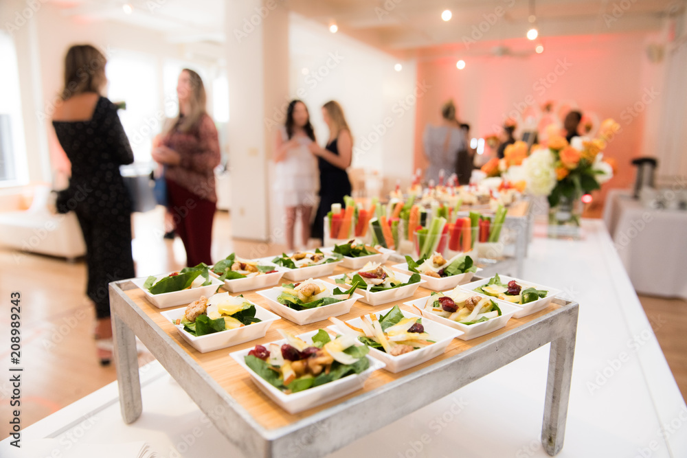 Fototapeta Healthy organic gluten-free delicious green snacks salads on catering table during corporate event party