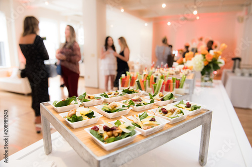 Fototapeta Healthy organic gluten-free delicious green snacks salads on catering table during corporate event party obraz