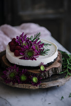Close Up Of Cake Garnished With Flowers