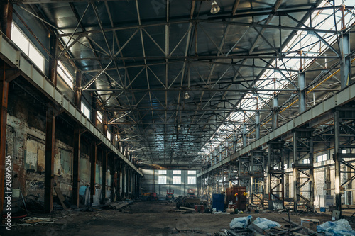Foto op Canvas Industrial geb. Ruined industrial hall of warehouse or hangar in process of reconstruction