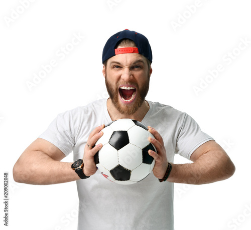 Obraz na plátně  Soccer fan man hold ball celebrating happy laughing shouting screaming out loud