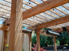 Outdoor Restaurant Set Up With Patio And Wooden Overhang And Speakers