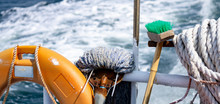 Cleanliness Tool Including Mob And Brush With Handle, Safety Buoy And Old White Rope At The Stern Of Island Ferry Near Coastalline In Geoje Island, South Korea