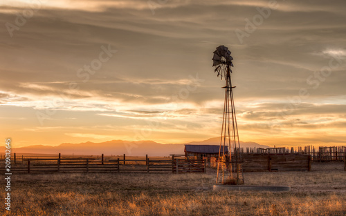 Old Windmill on a Farm at Sunset